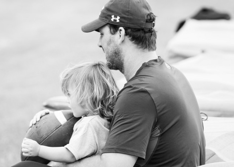 Tony Romo holds his son, Rivers (2). (Photo by Dan Garcia/The Early Registration)