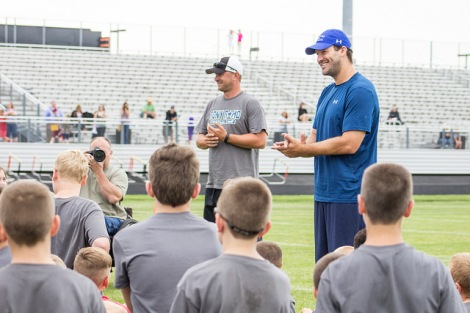 Burlington Coach Steve Tenhagen and Tony Romo teaching the fundamentals to kids. (Photo by Dan Garcia/The Early Registration)