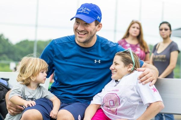 Tony Romo and son Rivers (2) meet a fan in Burlington, WI. (Photo by Dan Garcia/The Early Registration)