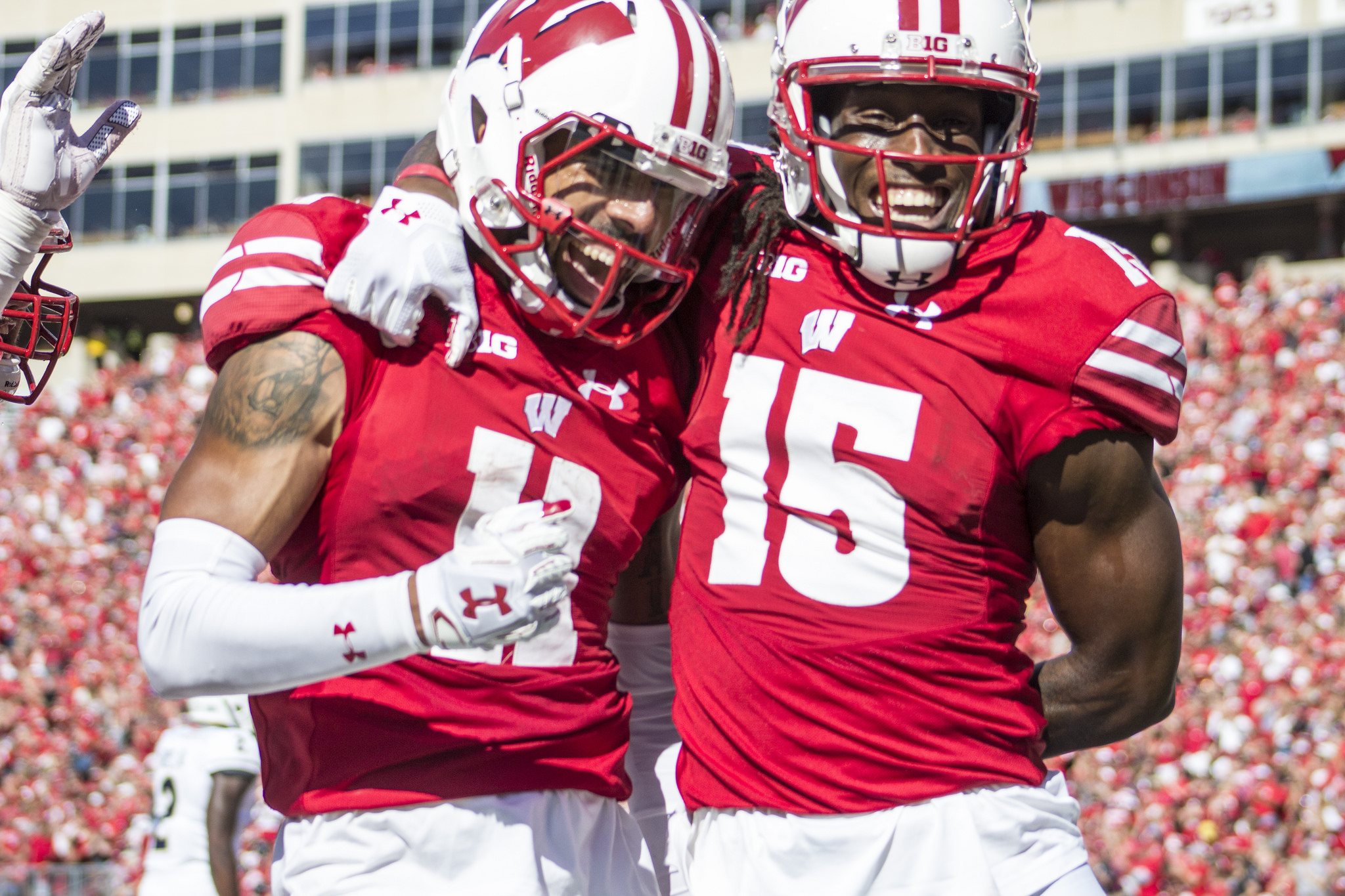 Clement scores twice, No. 10 Wisconsin stuffs Akron 54-10